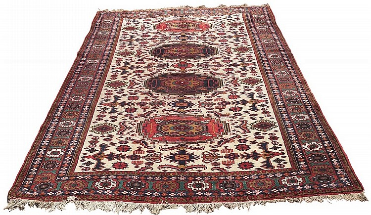 A good Caucasian carpet with four central medallions in a row, the two inne