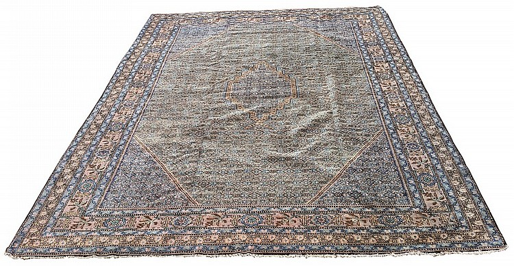 A fine Persian Ardabil rug, central geometric medallion on blue ground surr