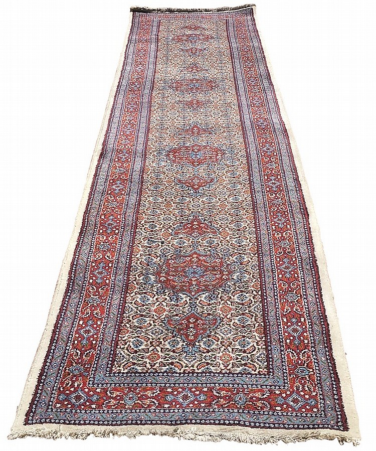 A good Persian Mood runner with four red medallions, each with an arrow for
