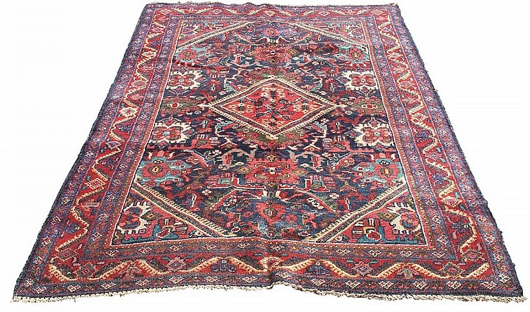 A Ziegler Mahal rug, central red diamond medallion on blue ground filled wi