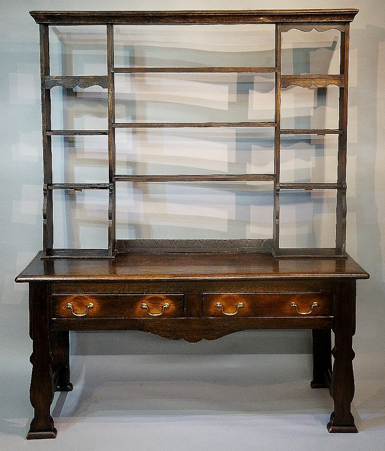 An early George III style oak dresser with rack, the shelved back with flar