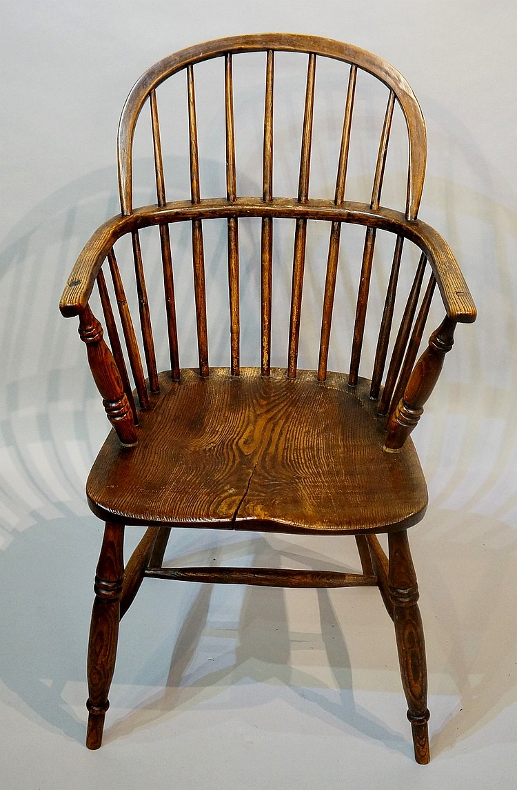 A 19th Century ash and elm Windsor elbow chair with saddle seat on turned s