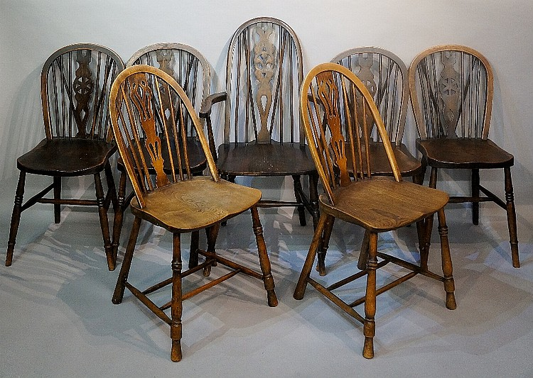 Seven various wheel back and other kitchen chairs, including: a set of four