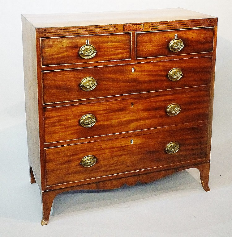 A Regency mahogany chest of drawers with caddy top outlined with ebonised s