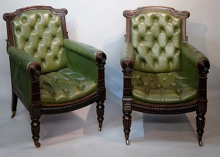 A pair of William IV mahogany framed library chairs in Gillow's style, the