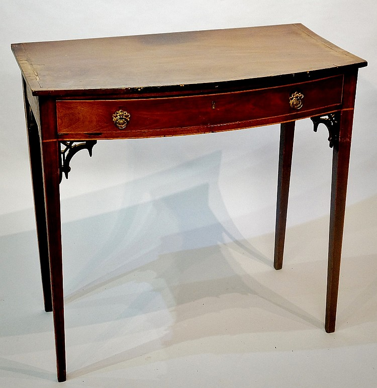 A George III mahogany single drawer side table, the over sailing bow-front