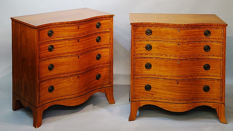 A pair of George III style satinwood chests of serpentine outline, outlined
