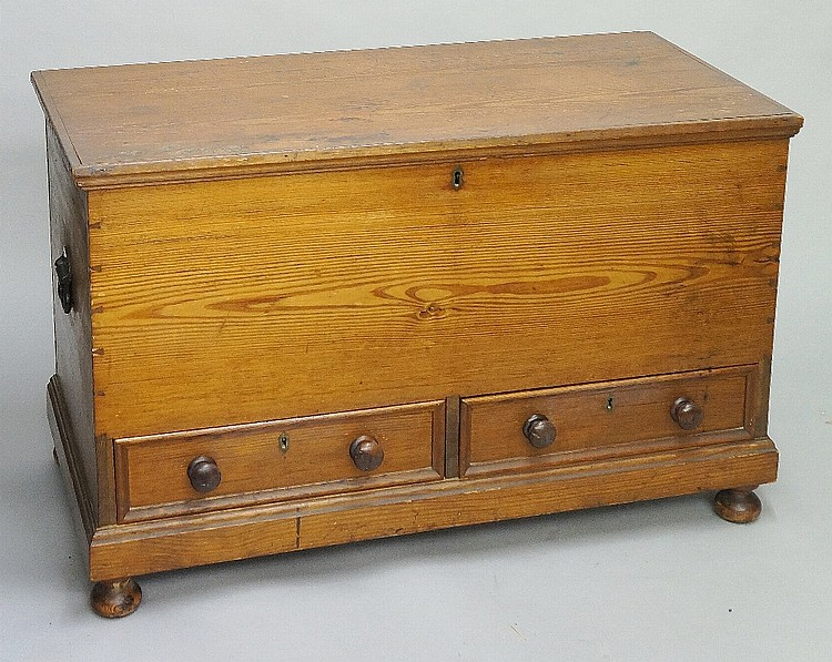 A Victorian pine blanket or mule chest, the hinged lid above a deep front f
