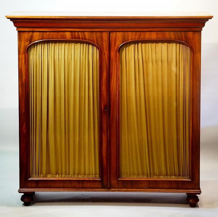 A Victorian mahogany bookcase top with figured arched glazed doors, beneath