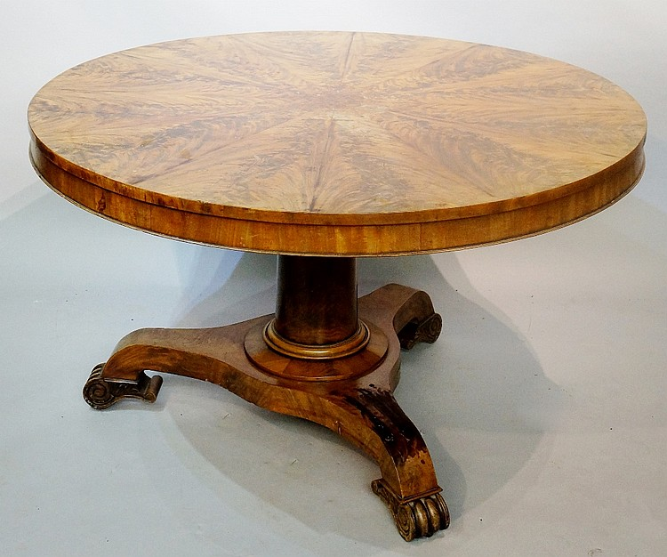 An early Victorian figured mahogany segmental top centre table with shallow