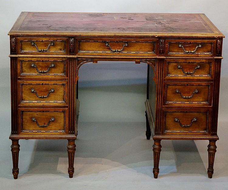 A Victorian walnut pedestal desk, the rectangular top inset with gilt toole