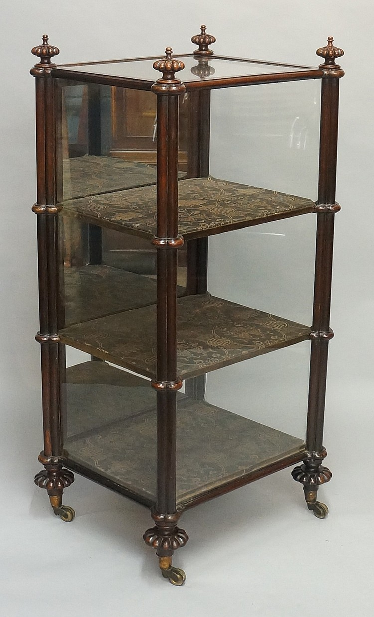 A Victorian rosewood display cabinet, the glazed case with cluster column a