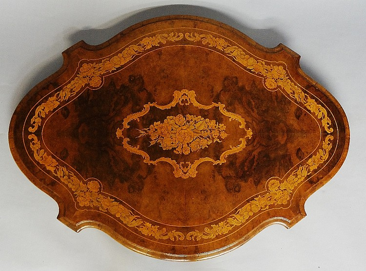 A Victorian inlaid figured burr walnut shaped oval loo table, the top finel
