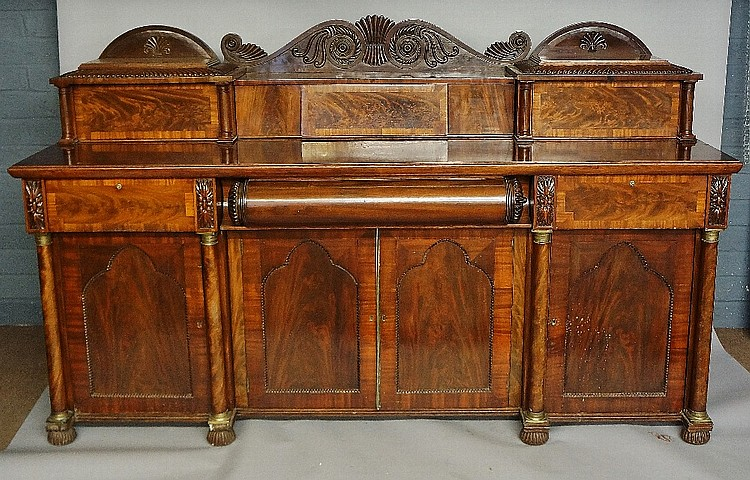 A William IV mahogany sideboard of monumental proportions, the back anthemi