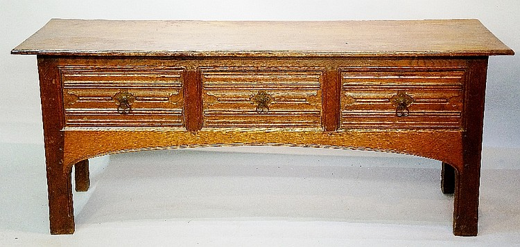 Robert Lorimer? - an oak sideboard, the over sailing rectangular top above