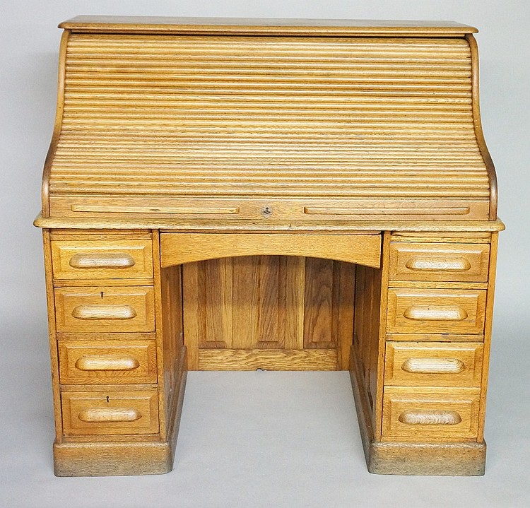 An Edwardian oak roll top desk of conventional design, S-tambour front reve