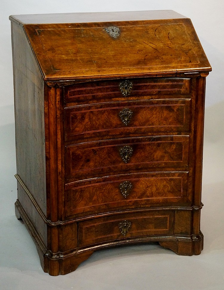An unusual late 17th / early 18th Century walnut bureau, outlined throughou