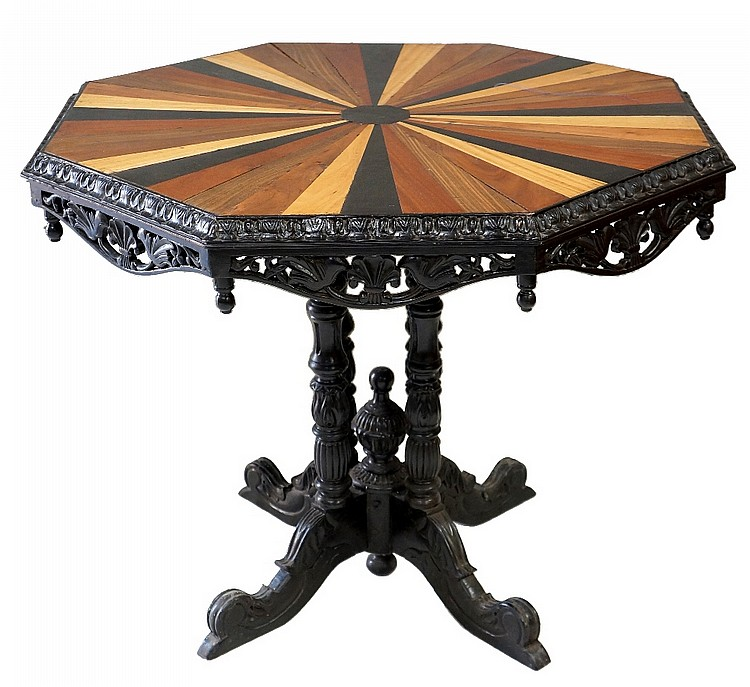 An Anglo-Indian octagonal centre table, the segmental coloured wood top cen