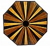 An Anglo- Indian octagonal centre table the top inlaid in coloured woods ce