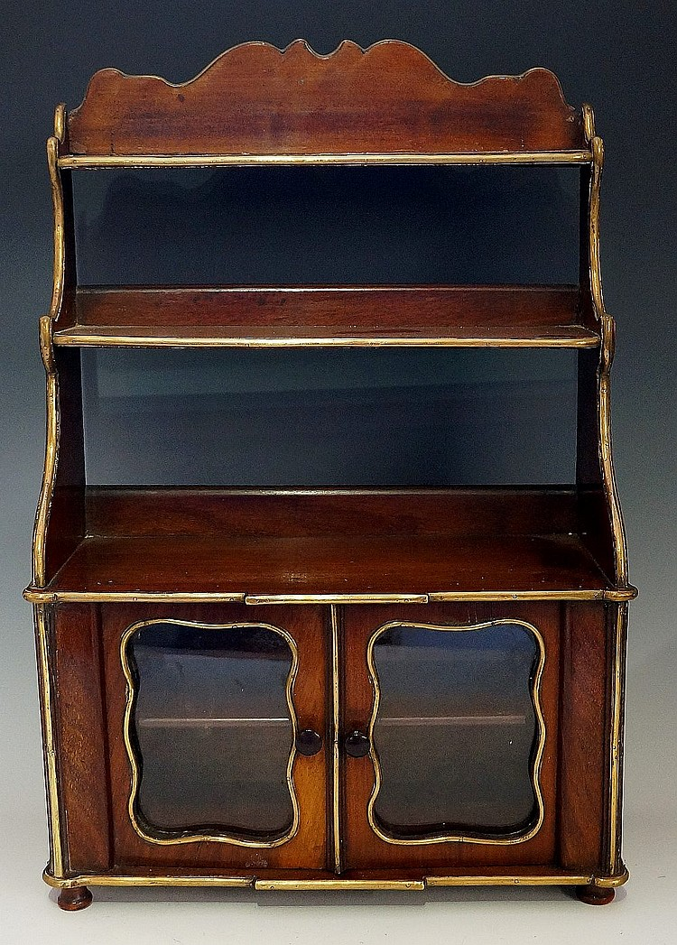 A late 19th Century French mahogany miniature chiffonier, brass mounted thr