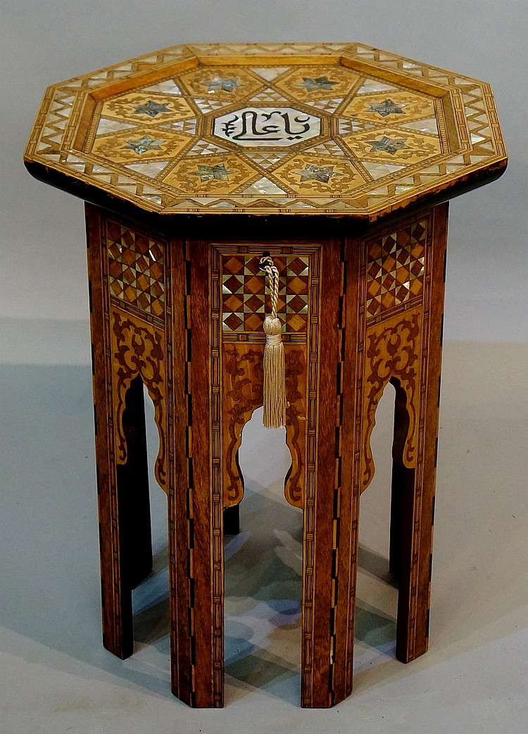 A Syrian octagonal work table, the panelled top inlaid to the centre with m