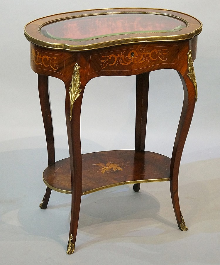 A French rosewood veneered kidney shaped bijouterie table in Louis XVI styl