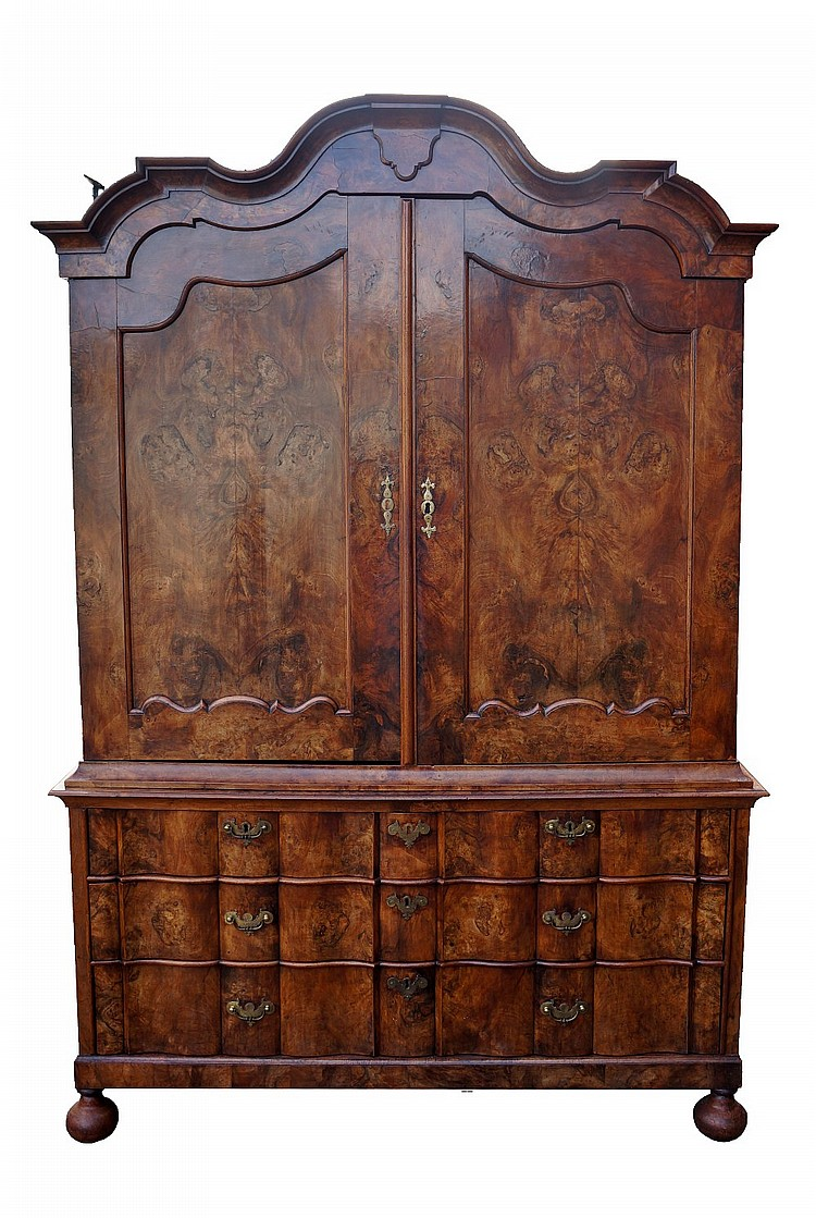 A mid 18th Century Dutch figured walnut cupboard, the cornice cavetto mould