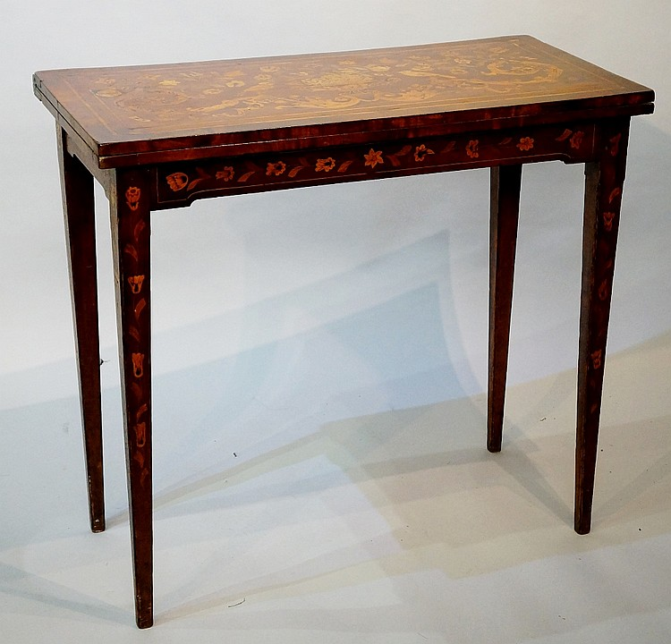 An 18th Century continental mahogany fold-over card table of rectangular ou