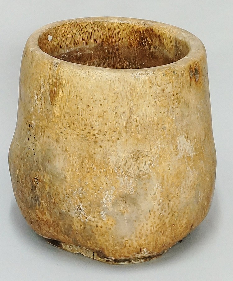 A large banana root vessel of bellied cylindrical form, 52cm high, 20th Cen
