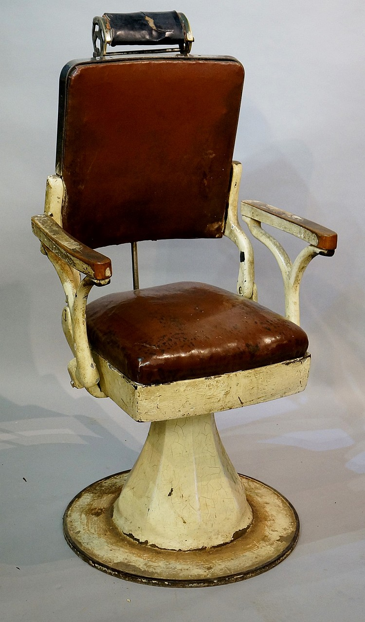 A continental cream enamelled metal barber's chair, the back with adjustabl