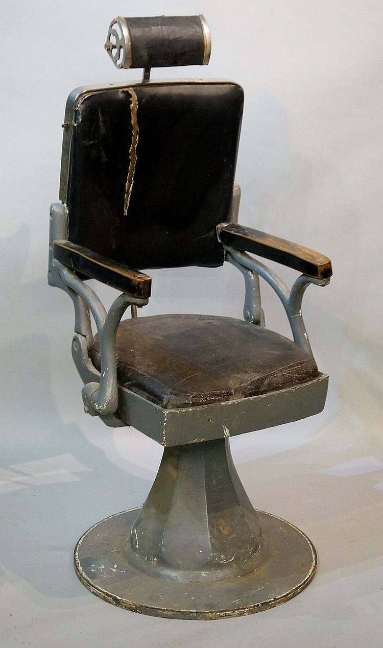 A continental enamelled metal barber's chair with adjustable head rest, the
