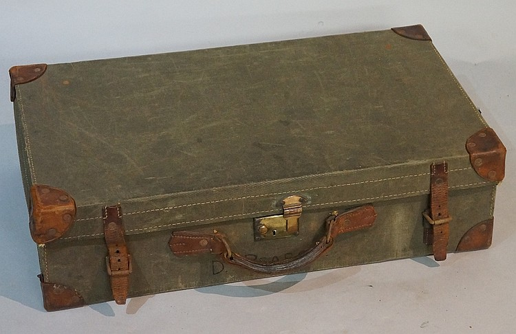 An olive green canvas case with leather mounted corners and straps, red cot