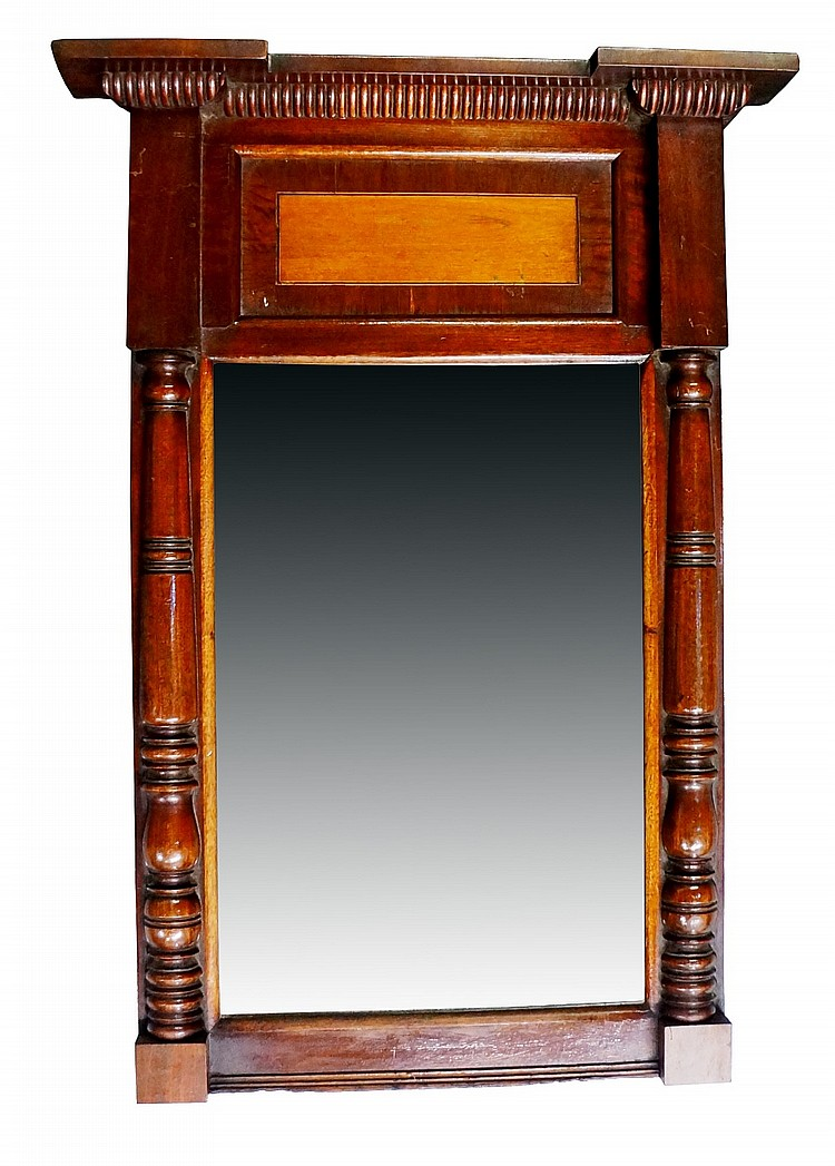 A George IV inverted breakfront mahogany pier glass with panelled frieze ce