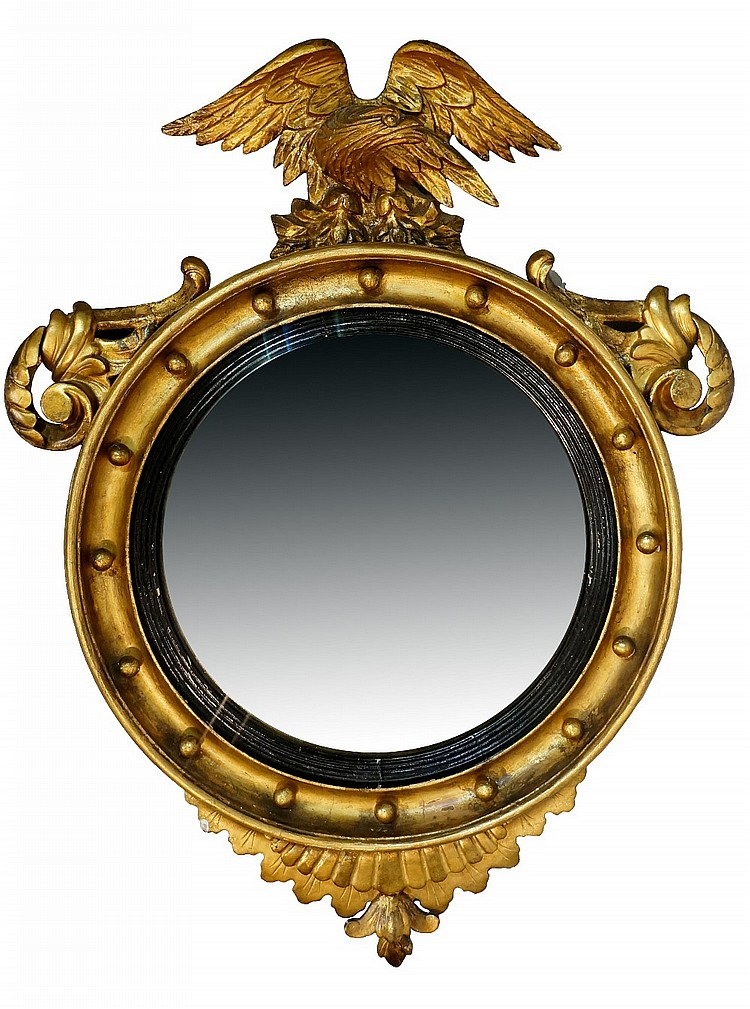 A Regency giltwood convex circular mirror with concave border set spheres a
