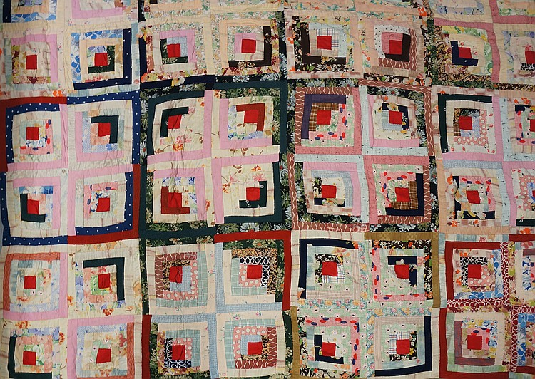 An early to mid 20th Century log cabin patchwork quilt