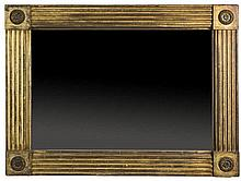AMERICAN CLASSICAL GILDED PIER MIRROR WITH REEDED SIDES AND CORNERS WITH BRASS ROSETTES.
