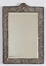 TABLE-TOP MIRROR IN A ROCOCO SILVERED FRAME.
