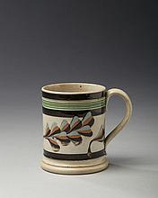 BRITISH CREAMWARE MOCHAWARE MUG, CIRCA 1820.