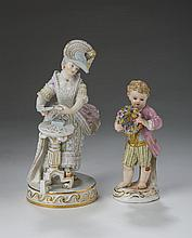 MEISSEN PORCELAIN GARDEN FIGURE OF A BOY WITH WREATH; AND A FIGURE OF A LADY CARD PLAYER, 1850-1924.