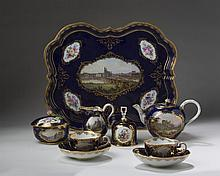 MEISSEN PORCELAIN COBALT BLUE-GROUND TOPOGRAPHICAL CABARET SERVICE, LATE NINETEENTH CENTURY.