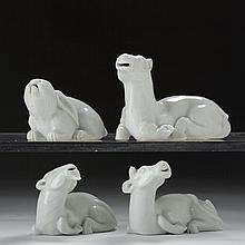 FOUR CHINESE BLANC-DE-CHINE PORCELAIN FIGURAL WATER DROPPERS OF RECUMBENT ANIMALS, PROBABLY EIGHTEENTH CENTURY.
