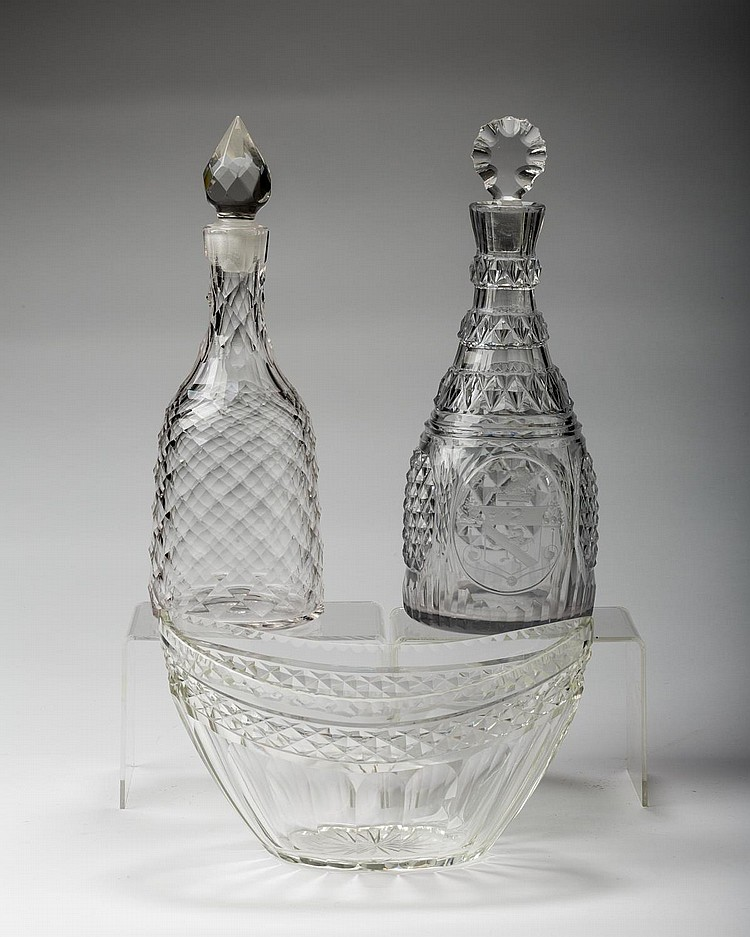 TWO ENGLISH OR AMERICAN CUT-GLASS DECANTERS AND STOPPERS AND A SMALL CENTERBOWL, NINETEENTH CENTURY.