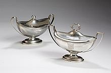 TWO GEORGE III SILVER ARMORIAL SAUCE TUREENS AND COVERS, LONDON: THE FIRST, JOHN WAKELIN & WILLIAM TAYLOR, LONDON, 1787-88; THE SECOND PAUL STORR, 1799-1800.