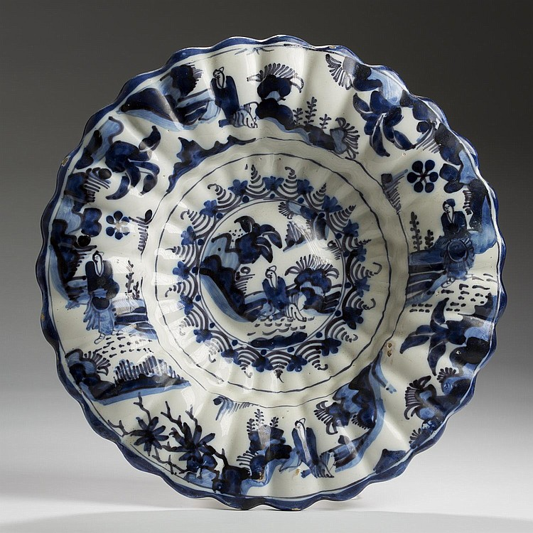 DUTCH DELFT CHINOISERIE BLUE AND WHITE LOBED DISH.