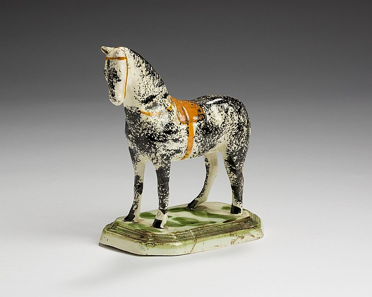 ENGLISH PEARLWARE FIGURE OF A RACEHORSE, 1800-10.