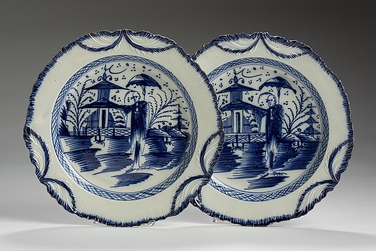 PAIR OF YORKSHIRE PEARLWARE BLUE AND WHITE 'LONG ELIZA' SWAGGED SHELL-EDGE PLATES, ATTRIBUTED TO LEEDS OR SWINTON, 1780-90.