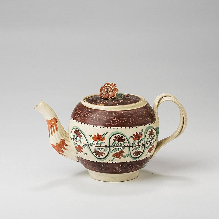 ENGLISH CREAMWARE ENAMELLED 'CHINTZ' PATTERNED TEAPOT AND COVER, 1770-80.