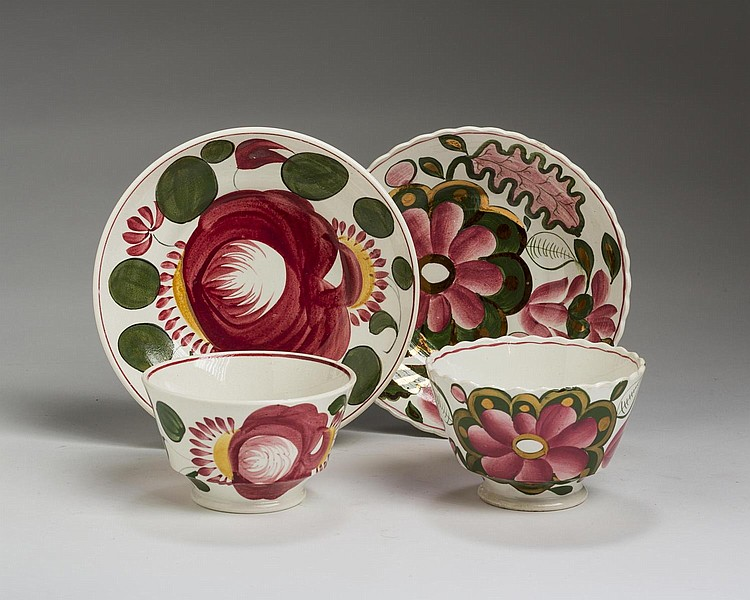 STAFFORDSHIRE GAUDY DUTCH TEABOWL AND SAUCER, AND A GAUDY WELSH TEABOWL AND SAUCER, BOTH CIRCA 1820.