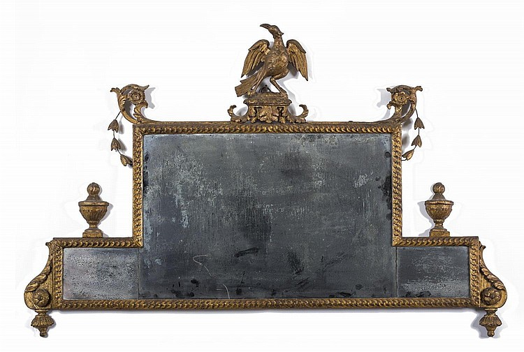 CONTINENTAL CARVED GILTWOOD OVER-MANTEL OR CHIMNEY GLASS WITH THREE-PART PLATE, LATE EIGHTEENTH CENTURY.