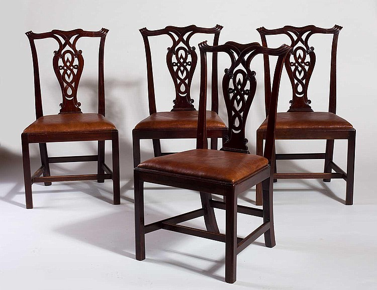 SET OF FOUR CHIPPENDALE MAHOGANY DINING CHAIRS.
